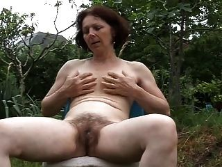 My Neighbor Masturbates In Garden Herself