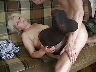 Mature Blonde In Stockings Fucks The Boy