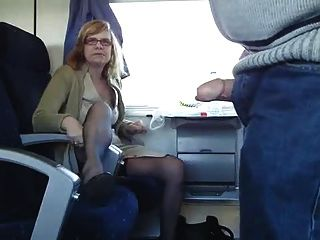 Mature Couple Having Fun On A Train