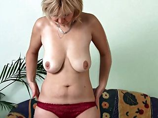Mature Masturbating On The Sofa