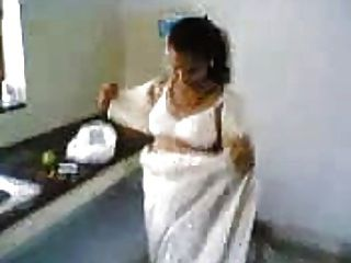 Indian Wife In Kitchen