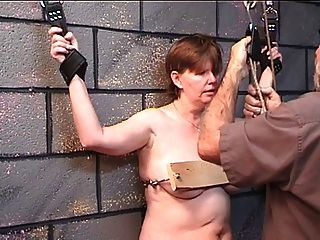 Fat Woman Gets Her Boobs Nailed In Wood In Dungeon Play With Older Master