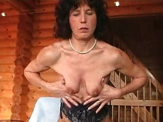 Mature In Stockings Inserts Dildo
