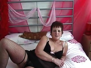 Granny In Fishnets Strips And Fingers