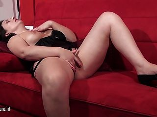 Mature European Woman Masturbating On The Couch