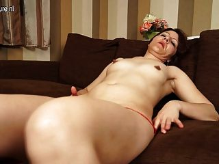 Mature Slut Mother Playing With Her Pussy On Couch