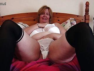 British Mature Lady Shows Her Big Tits And Masturbates