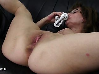 Mature Mom Riding A Dildo On Her Couch