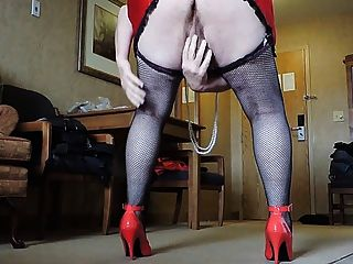 Sissy Ray In Red Miniskirt And Black Fishnet Stockings