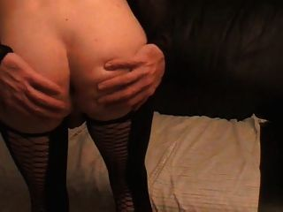 Tara Crossdress Is Posing In Black Nylons And Shows Ass