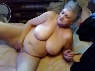 Highly sexed mom gives her hairy pussy a treat 9
