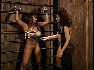 Chained to wall gets flogged and gives blowjob