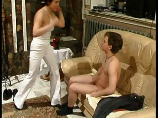 Mature Lady Dominates Young Man
