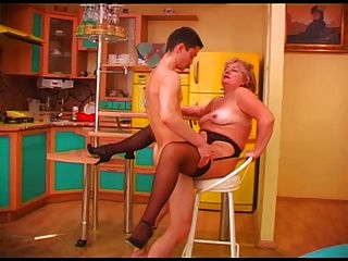 Plump Mature Smiling Blonde In Stockings And A Guy