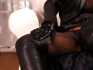 Hot Brunette Teasing In Leather And High-heel Boots
