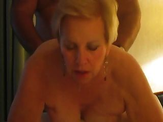 Look into the camera blonde cougar smoking doggystyle