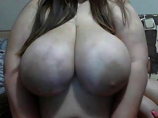 Huge Breasts Being Sucked