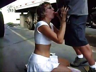Mature Woman Sucks Cock Between Trucks In Parking Lot