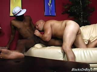 Chubby Bald Guy Does Decent Deepthroat On A Black Cock